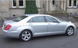 modern silver mercedes wedding car